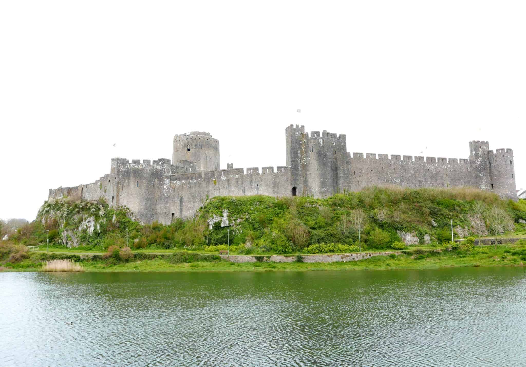 Looking at Pembroke Castle over the Water | My Travel Monkey